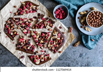 Homemade chocolate bark with hazelnuts, peanuts, cranberries and freeze dried raspberries