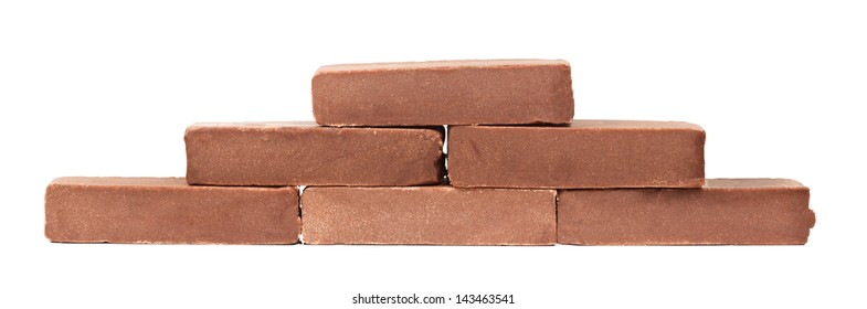 Homemade chocolate bars over white background