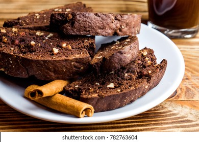 Homemade chocolate biscotti cookies with almond on white plate. Close up