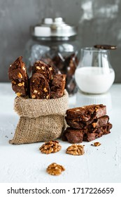 Homemade chocolate biscotti cookies with walnuts and a glass of milk