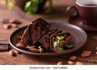 Homemade chocolate brownie on the wooden table.