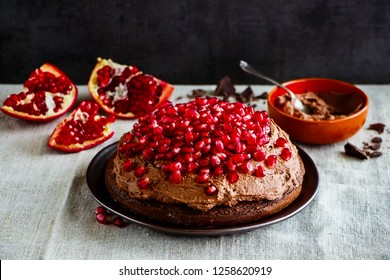 Homemade chocolate cake with fresh pomegranate and mascarpone cream