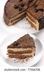 Homemade chocolate cake on white plates.