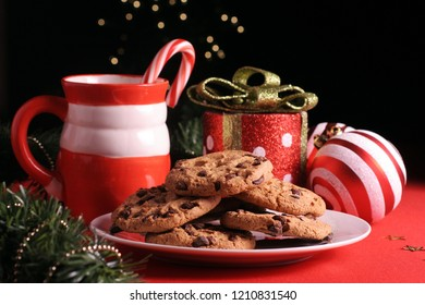 Homemade chocolate chip cookies and mug with hot chocolate (focus on cookies)