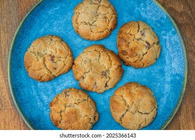 Homemade chocolate chip cookies on a turquoise plate