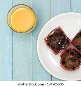 Homemade Chocolate Chip Muffins and Orange Juice