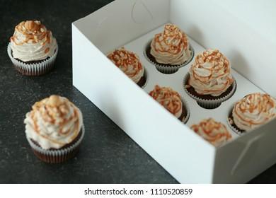 Homemade chocolate cupcakes with mascarpone cream and hazelnut