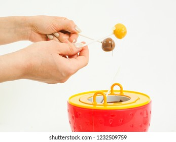 Homemade chocolate dipping candy with female hands