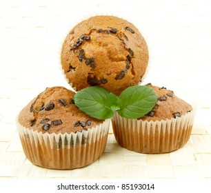 homemade chocolate muffins with fresh mint leaves
