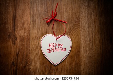 Homemade Christmas decoration, wooden heart which reads 'Merry Christmas'