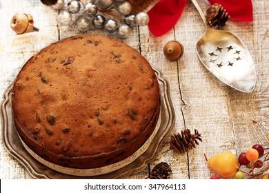 Homemade Christmas fruit cake on holiday background, selective focus