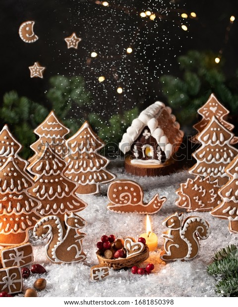 Homemade Christmas gingerbread cookies in the form of squirrels and trees, arranged as a story in the forest