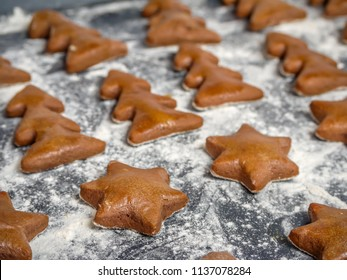 Home-made christmas gingerbread star and xma tree-shape cookies