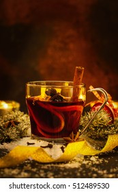 Homemade christmas mulled wine or hot tea with cinnamon, anise and oranges. Toned image. Selective focus
