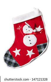 Homemade christmas sock with a snowman with stitch broom, cap, shawl, button eyes, patches and stars on a red background.