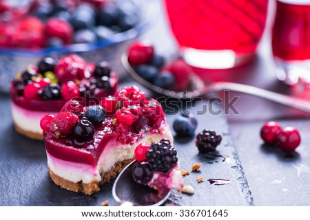 Homemade Christmas winter berry fruit cheesecake on board