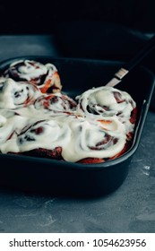 Homemade cinnabons cinnamon rolls with cream cheese glaze.