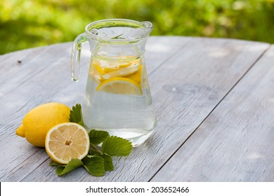 homemade citrus lemonade in pitcher on the table