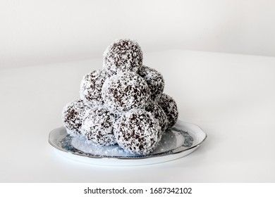 Homemade coconut / cocoa balls on Herend porcelain plate.