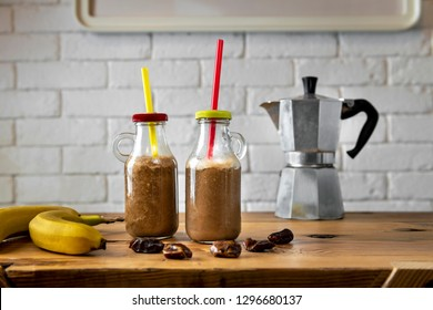 Homemade coffee banana smoothies with dactyls or white brick wall background