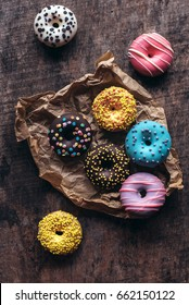 Homemade colorful donuts on the wooden table,selective focus