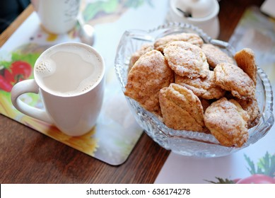 Homemade cookies and cup of coffee with milk