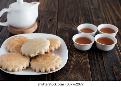 Homemade cookies with a cup of tea on old wooden background