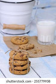 Homemade cookies with glass of milk on wooden table.