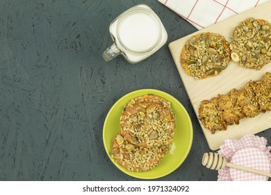 Homemade cookies with seeds and honey caramel. Caramel and sunflower seeds and pumpkin seeds and nuts. Delicious veggie biscuits. Background and space for text