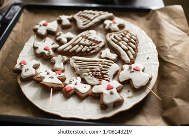 Homemade cookies in shape of angels and wings.