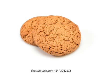 Homemade cookies. Two sweet cookie made from oatmeal flour. Tasty biscuit in high resolution close up isolated on white background. Homemade bakery.