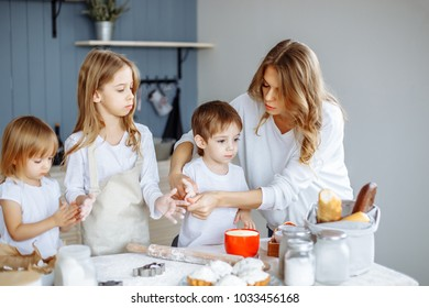 Homemade cooking. Happy family makes cakes together in the kitchen.