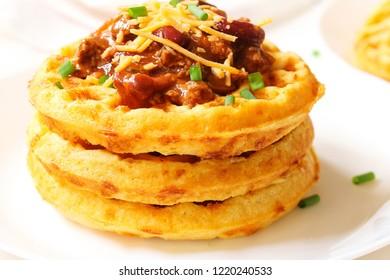 Homemade Cornbread Waffles topped with Turkey bean chili close up / Thanksgiving breakfast