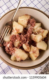 homemade corned beef hash with fork in a bowl