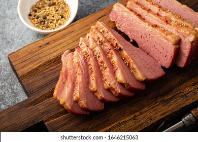 Homemade corned beef sliced on a cutting board