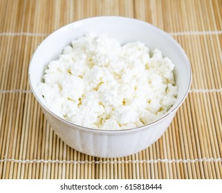 Homemade cottage cheese in a ceramic bowl