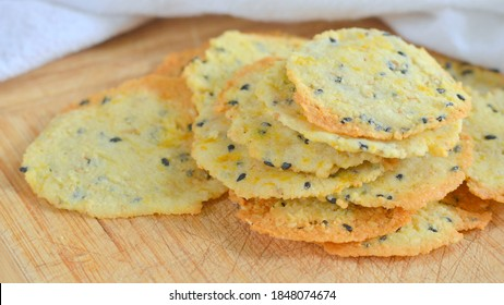 Homemade Crackers on a Wooden Board; made using almond flour and suitable for a ketogenic, low carbohydrate or gluten free diet.