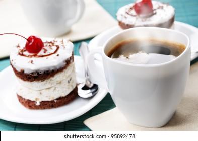Homemade cream cherry cake and coffee cup