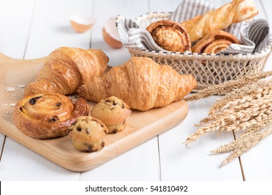 Homemade croissant  and bakery on white wood background, breakfast food