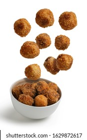 Homemade croquettes flying isolated from white background