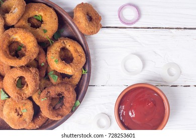 Homemade crunchy fried onion rings with sauces