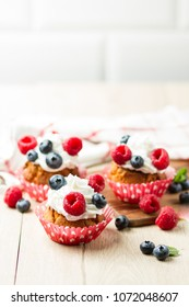 Homemade cupcake with berries and creame