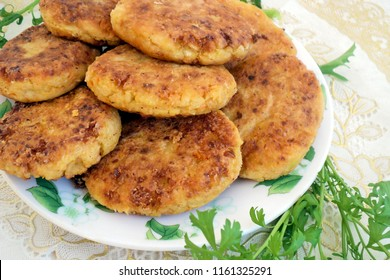 Homemade cutlets with fresh vegetables and herbs. Vegetarian food. Healthy diet food. Close up view. Homemade cutlets. patties with cabbage on a white plate on the table. homemade recipes