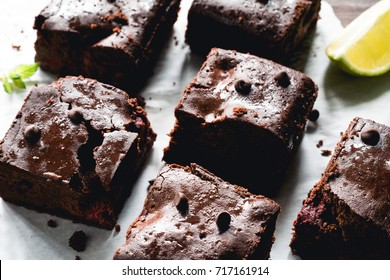 Homemade dark chocolate brownie squares closeup view