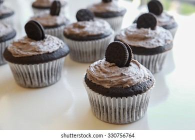 Homemade dark chocolate cupcakes with cookie and cream frosting