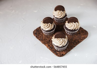 Homemade dark chocolate cupcakes with cookie and cream frosting. Selective focus