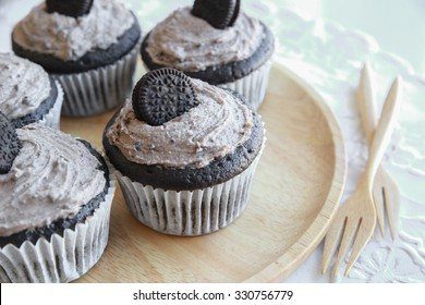 Homemade dark chocolate  oreo cupcakes with cookie and cream frosting