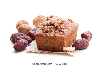 Homemade  date and walnut loaf cake isolated on white