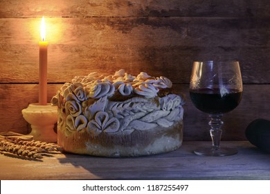 Homemade decorated Serbian slava bread with red wine and candle