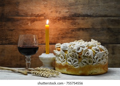 Homemade decorated Serbian slava bread with red wine